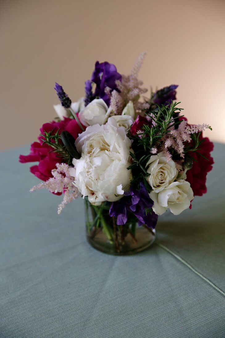 Hobnail jars were filled with a mix of roses, pale pink astilbe, skyline ranunculus, white peonies and lilacs.