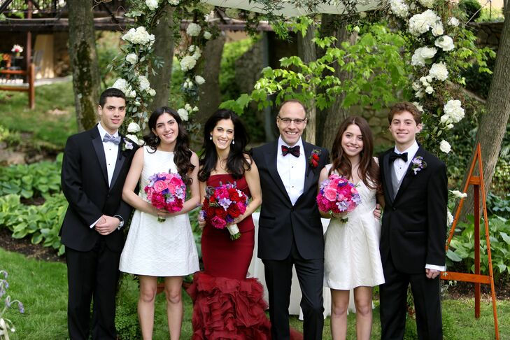 The bride and groom stood with their two daughters and two sons who made up their wedding party.