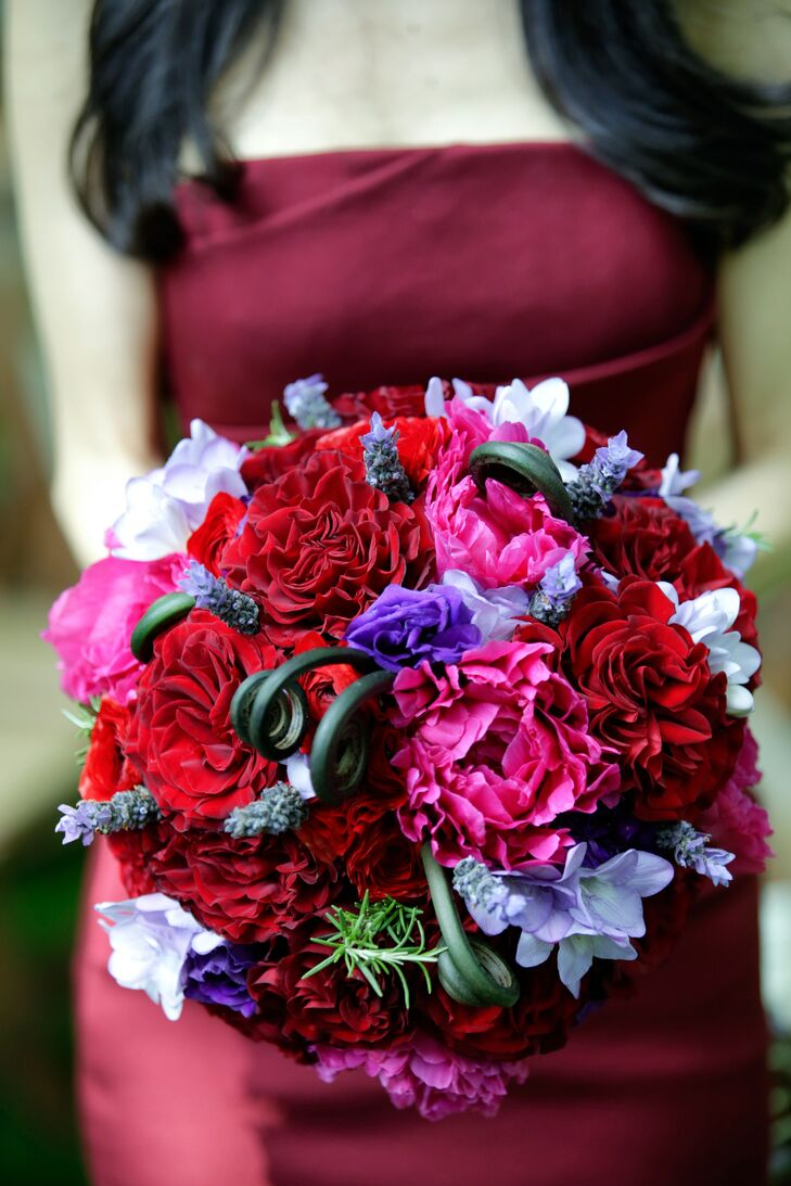 The bridal bouquet was a mix of peonies, garden roses, spray roses, ranunculus, freesia, lavender and fiddlehead ferns with a touch green, designed by TableArt.