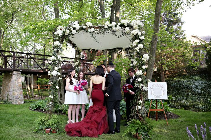 The couple were married under the chuppah surrounded by the stunning wooded area of the front lawn at Pomme. Garland accented with white hydrangeas and majolica spray roses decorated the top beam of the altar, draping onto the four poles.