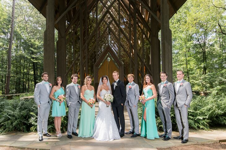 The bridesmaids wore mint dresses with silver shoes and the groomsmen wore gray suites with mint bow ties and suspenders and coral boutonnieres.