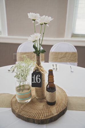 Rustic DIY Tree Stump Centerpieces with Twine-Wrapped Beer Bottles, Daisies, and Baby's Breath