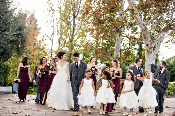 The romantic fall theme carried over into the wedding party's attire, with Lauren and Phil choosing a dramatic palette of bordeaux and gray for their bridesmaids and groomsmen. The girls donned strapless chiffon gowns for the occasion, while the guys kept it classy in traditional three-piece suits and Bordeaux ties.