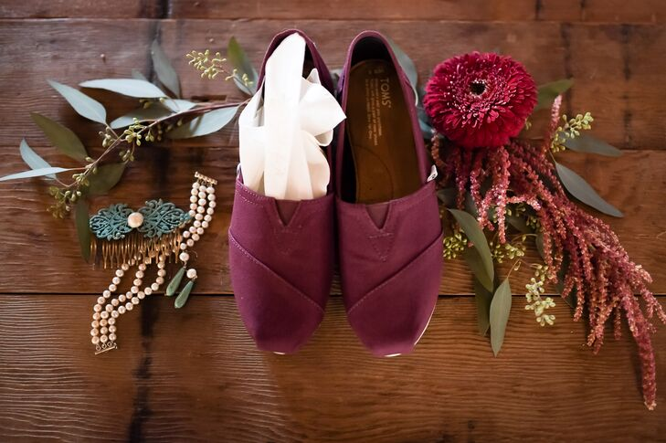 Sarah's shoes were practical maroon-colored Toms, not only because they were comfortable but also because Sarah is the same height as Matt and didn't want to tower over him. To complete her look, she borrowed a pearl bracelet from her mom.