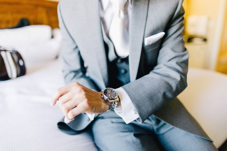 Tim accessorized his light gray suit with a silver watch, white tie, cuff links and white pocket square.