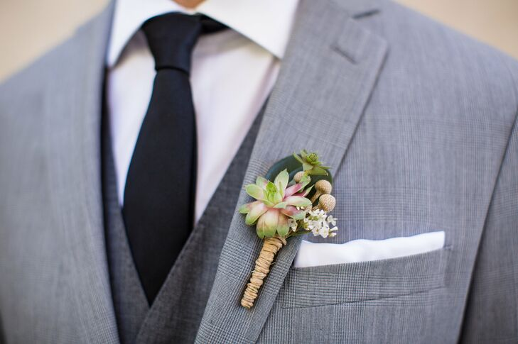 Neil wore tiny succulents accented with brunia berries on the lapel of his suit.