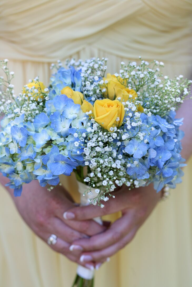 Jacquelyne's bridesmaids carried blue and yellow bouquets of roses, hydrangeas and baby's breath.