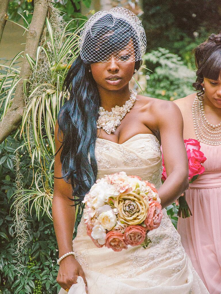 Long sideswept hairstyle with a birdcage veil