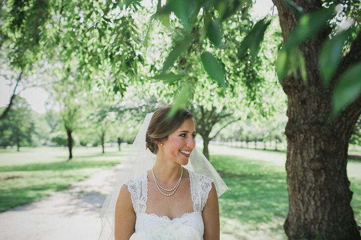 Bride in a Lace Wedding Dress and Pearls