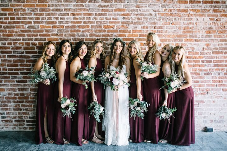 """I found my dress first and then created the rest of the attire from the style and look of it,"" Emily says of the merlot bridesmaid dresses, which fit her palette and design aesthetic."