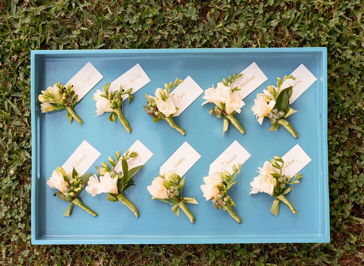 Cal and his groomsmen wore green and white boutonnieres made from blueberries and freesia.