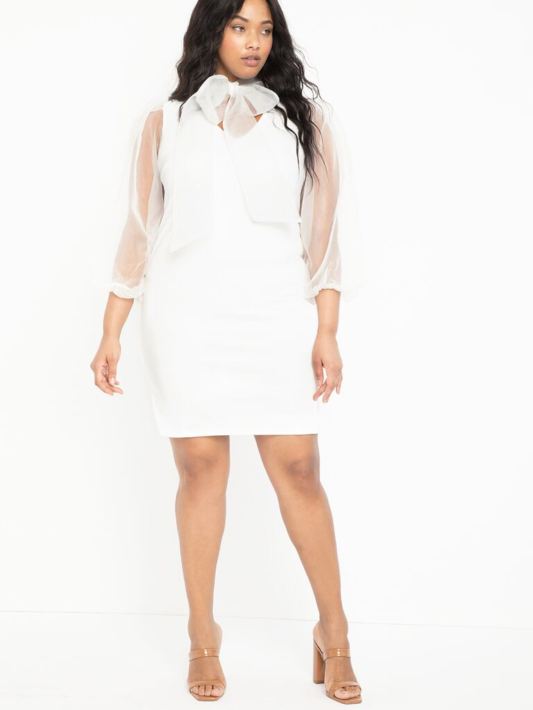 White plus size mini dress with sheer organza sleeves and tie neck