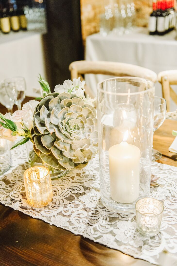 Dining tables had white lace runners draped down the middle, decorated with large succulent arrangements and white candles that gave off a romantic glow.