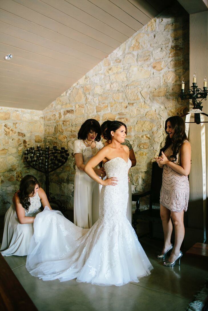 The bride wore a delicately beaded, strapless Mori Lee Gown. The light lace accents and flare finish were finished off with her veil and belt, both hand stitched by her mom! Her mom also designed and sewed her own entire wedding day outfit.
