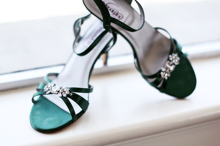 The bride chose emerald green bridal shoes because emerald green is her favorite color. The jewels on the shoes brought out the jewels on her belt.