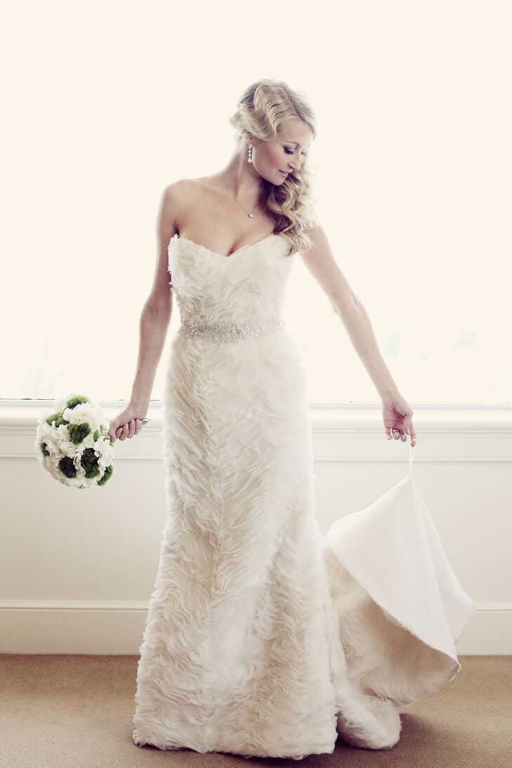 The bride chose a dramatic Romona Keveza gown because she wanted to evoke the feel of old Hollywood glamour. She accessorized with her grandmother's vintage jewelry and emerald green shoes.