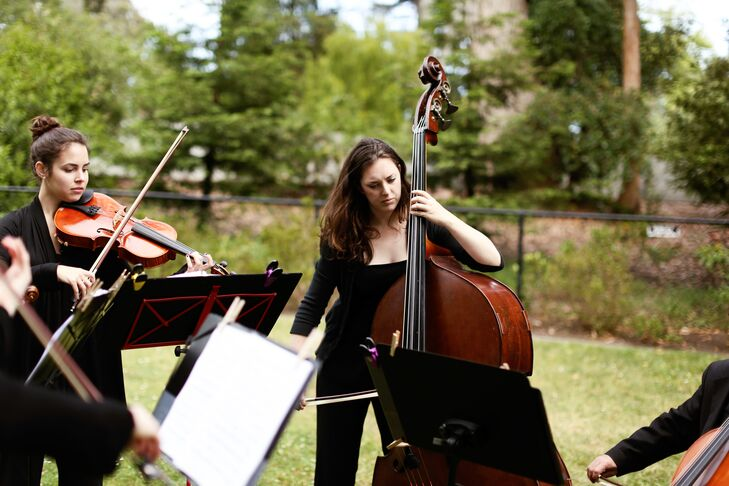 The groom hired local quintet, Innocenti Strings, and choose non-traditional music with a classic acoustical sound in Shakespeare's Garden. For her walk down the aisle, the bride chose Sweet Child O' Mine by Guns N' Roses played by 5 strings.