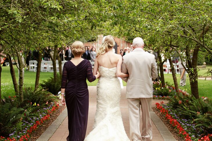 The bride was escorted down the aisle by both of her parents. Sweet Child O' Mine by Guns N' Roses was played by a local string quintet.