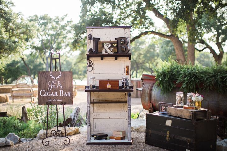 """""""JT's Cigar Bar"""" was set up on an area of the lawn, with cigars displayed on an old hutch as well as a vintage chest."""
