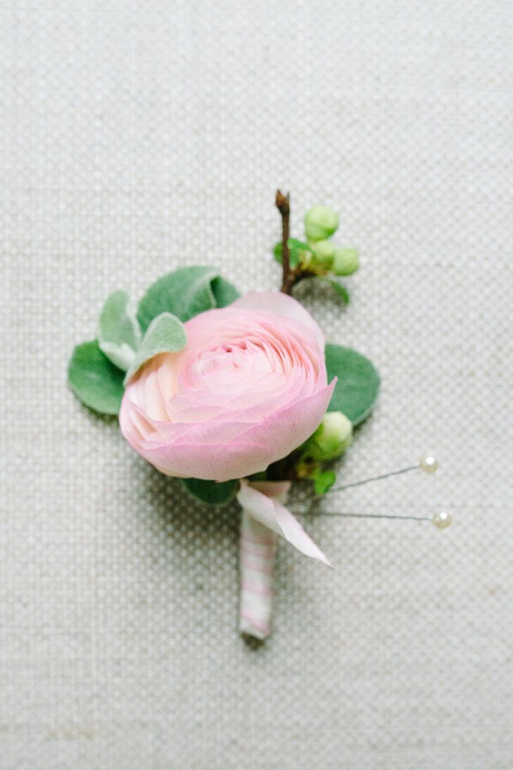 Travis completed his mid-blue Prada suit with a single pink ranunculus bloom on his lapel. He and Juliette loved how it fit their soft palette and the romance of Magnolia Plantation.
