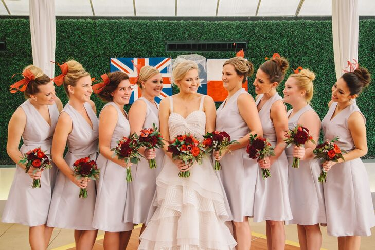 The bridesmaids wore sleek silver Alfred Sung dresses with red fascinators made by the bride's grandmother.