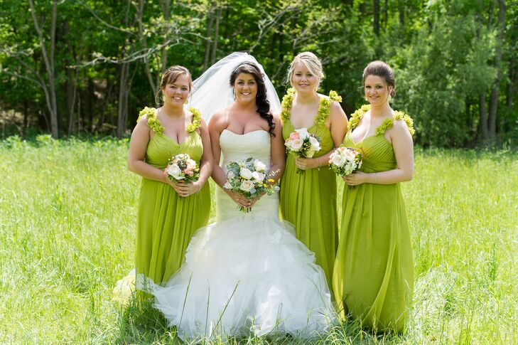 "Playing off the wedding's chartreuse and coral color palette, Tori decided to dress her bridesmaids in matching chartreuse gowns by Bari Jay. The floor-length chiffon gowns had a crisscrossed bodice, column pleating at the front and fabric flowers along the straps, giving the girls a whimsical appearance. ""I loved them so much that I wish I had one for myself!"" says Tori."