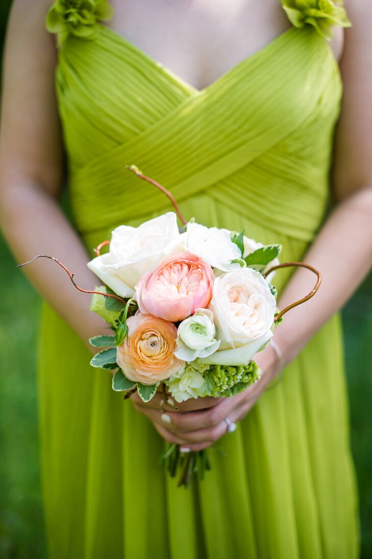 The bridesmaids carried smaller, brighter versions of Tori's own. Each filled with garden roses, ranunculuses and hydrangeas in shades of peach, pink, ivory and green, complementing the cheerful color of their dresses. Variegated greenery and wispy willow branches introduced a whimsical note to the bouquet.