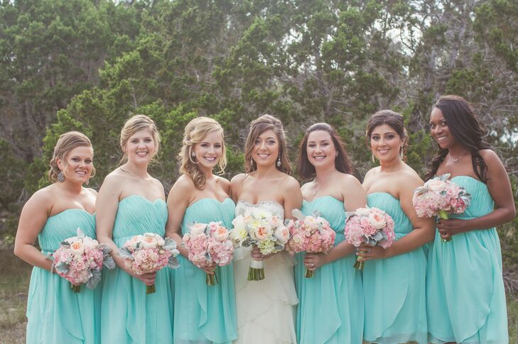 The bridesmaids wore aqua chiffon convertible dress from Nordstrom. For the ceremony they wore the dress as strapless, but for the reception they could bring parts of the skirt up and make it one shoulder, halter or two straps.