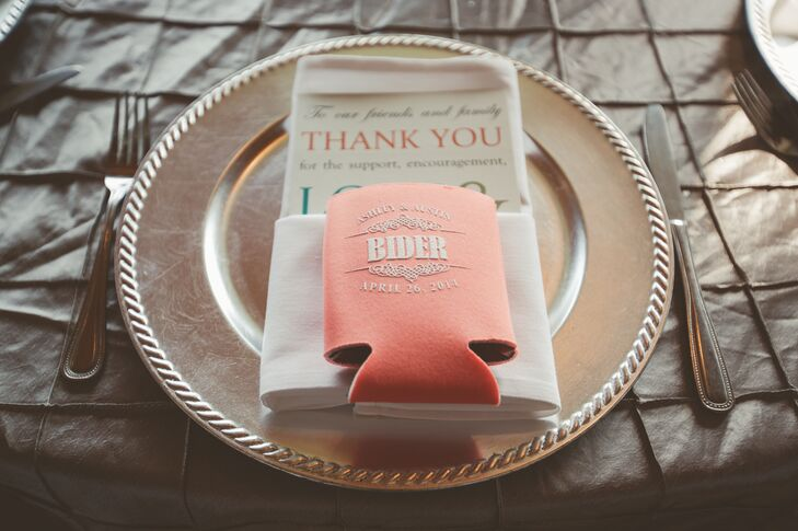 The couple gave their guests koozies in their color palette with a thank you card folded into the napkin at each place setting.