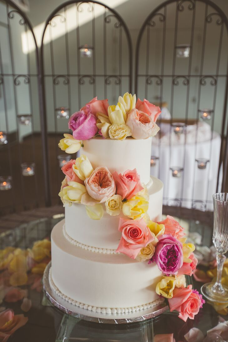 White Wedding Cake with Coral Cascading Flowers