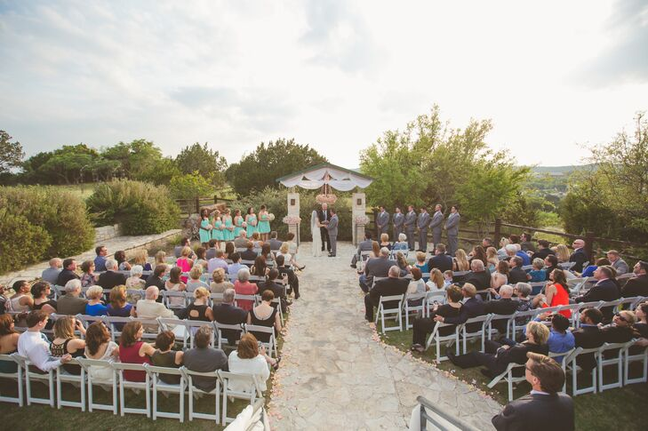 The ceremony was outside overlooking the Texas Hill Country. Afterwards, guests moved inside to the the second floor of the venue where there are floor to ceiling windows looking out onto the hills and countryside.
