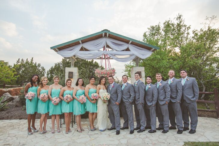 The groom and groomsmen wore gray tuxedos with gray vests and aqua ties that matched the bridesmaids' dresses. The groom wore a silver tie.