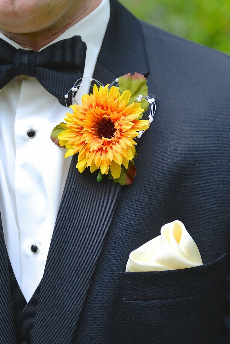 Faux sunflower bloom boutonniere on formal tux