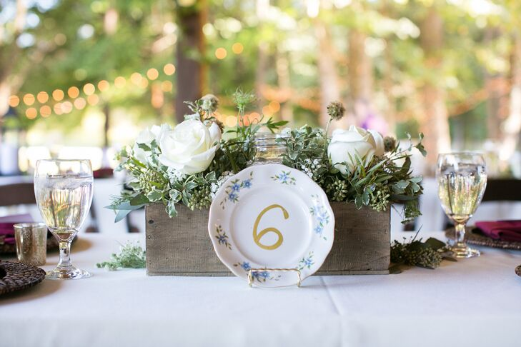 Victoria purchased mismatched china plates at local flea markets and painted them with table numbers.