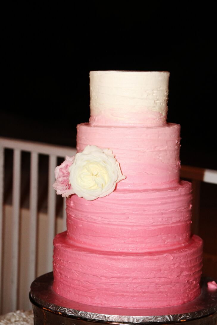 The couple chose a four-tier pink ombre wedding cake vendor from Key West Cakes. The strawberry shortcake confection was decorated with two white and pink garden roses.