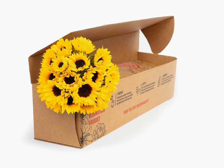 BloomsyBox delivery with bouquet of bright yellow sunflowers third anniversary gift idea