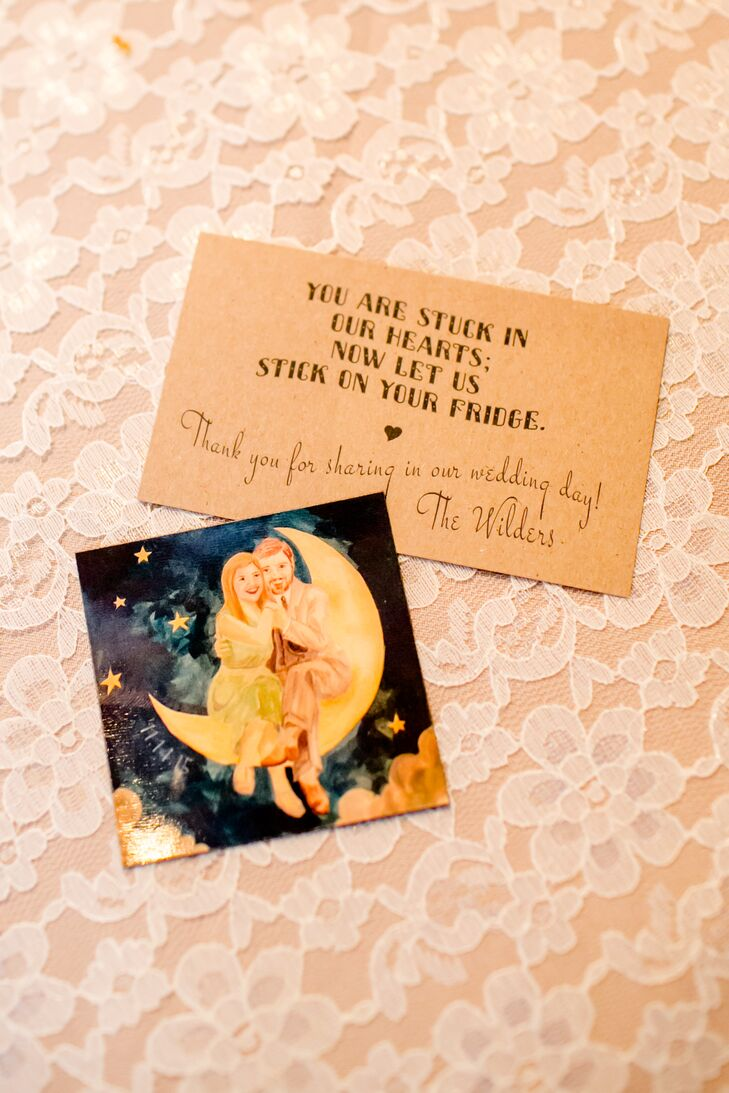 """Small square magnets of their watercolor wedding logo were printed and placed at every seat with a little card that read, """"You're stuck in our hearts. Now let us stick on your fridge."""""""