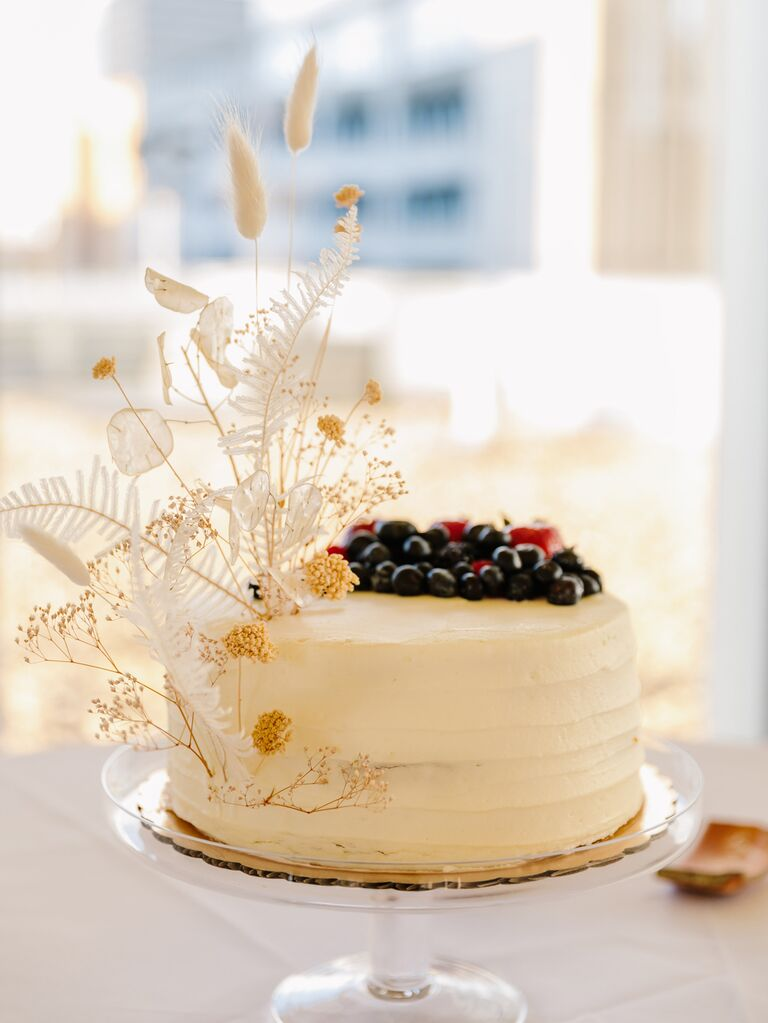 Simple wedding cake with pampas grass and fresh fruit