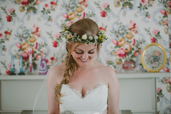 """Mary styled her hair in a fishtail braid and wore a flower crown made of blush roses, button mums, craspedia and wax flowers. """"I felt like a Norwegian fairy princess,"""" she says."""