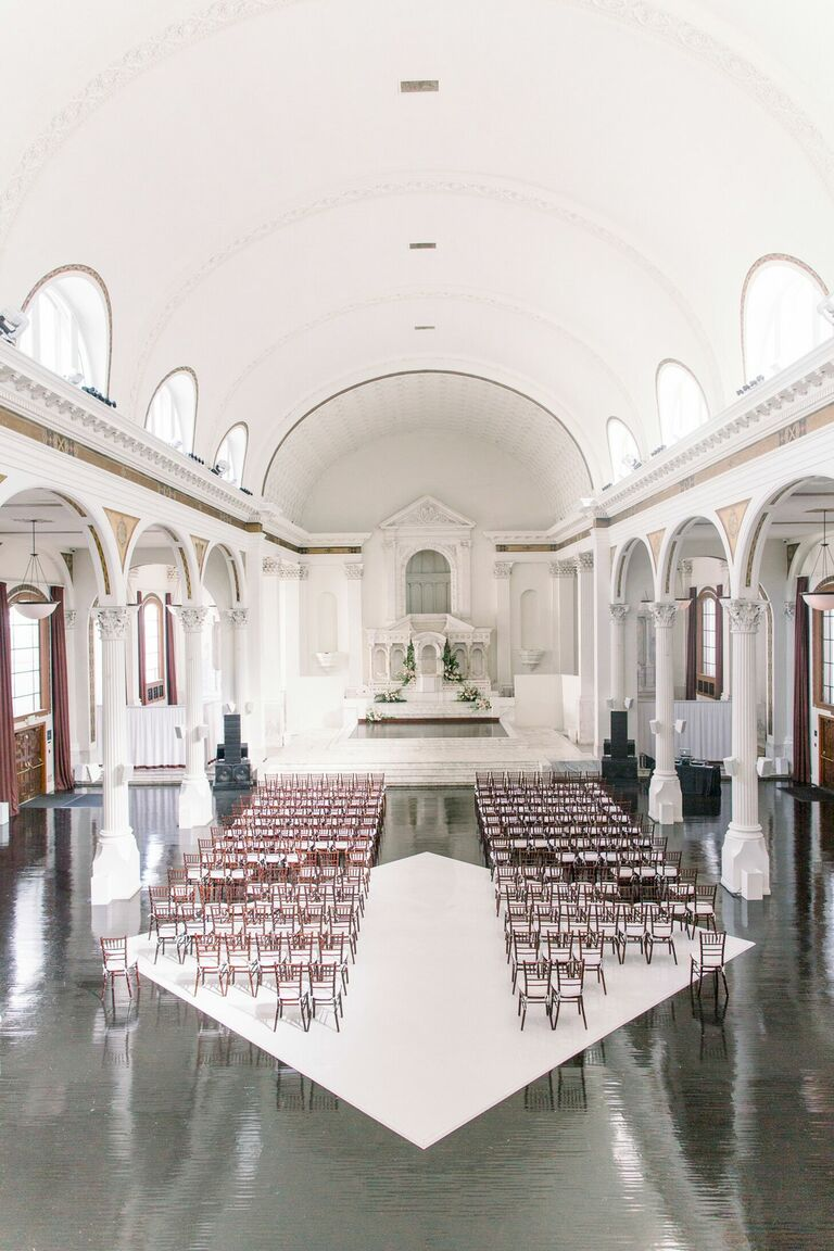 Ceremony in historic space with arches ceiling