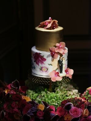 Elegant Wedding Cake with Orchids and Gold- and Floral-Painted Tiers