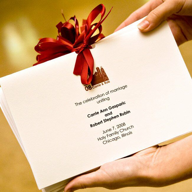 Simple programs emblazoned with the city skyline and tied with satin ribbon detailed the interfaith ceremony.