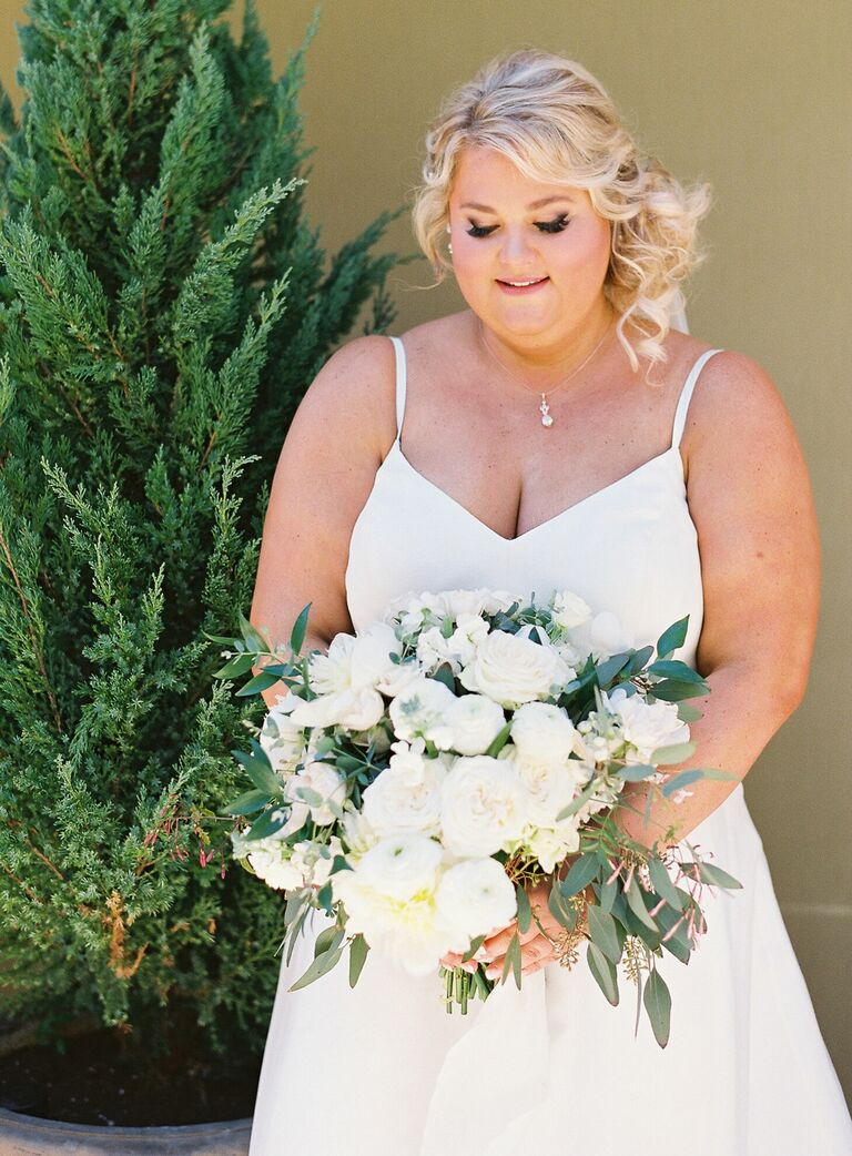 Bride holding textural white wedding bouquet