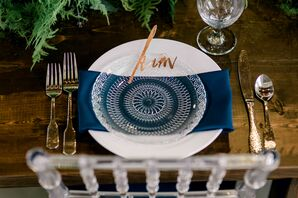 Vintage-Modern Place Setting with Blue Napkin and Gold Flatware