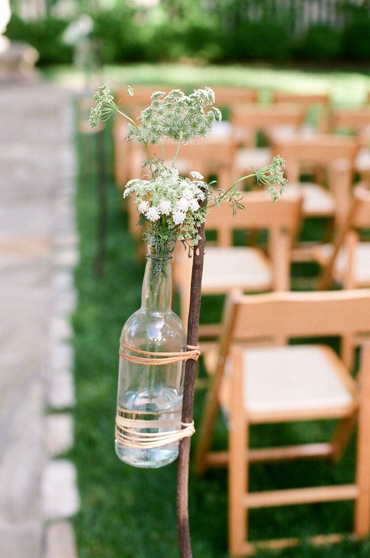 Queen Anne's Lace aisle decor in wine bottles