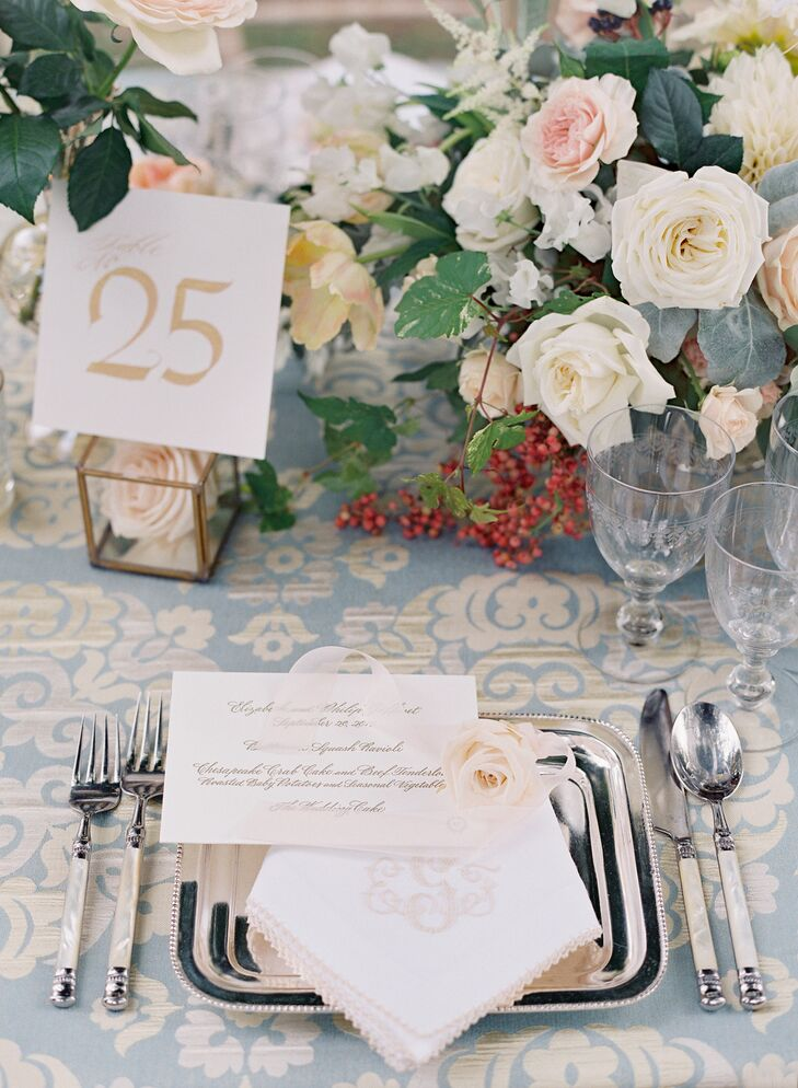 At the head table, guests found a monogrammed linen napkin and an apricot rose on top of square silver trays.