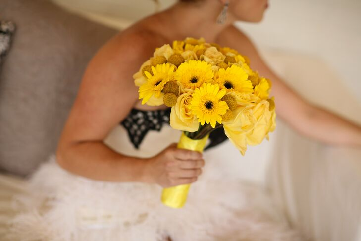 Tara carried a bright yellow bouquet filled with roses, craspedia and gerbera daisies.