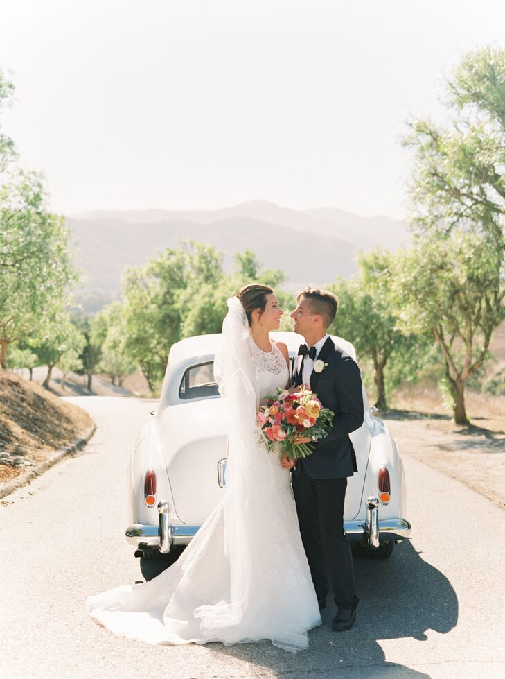 Bride and Groom with Vintage Car in Mountains