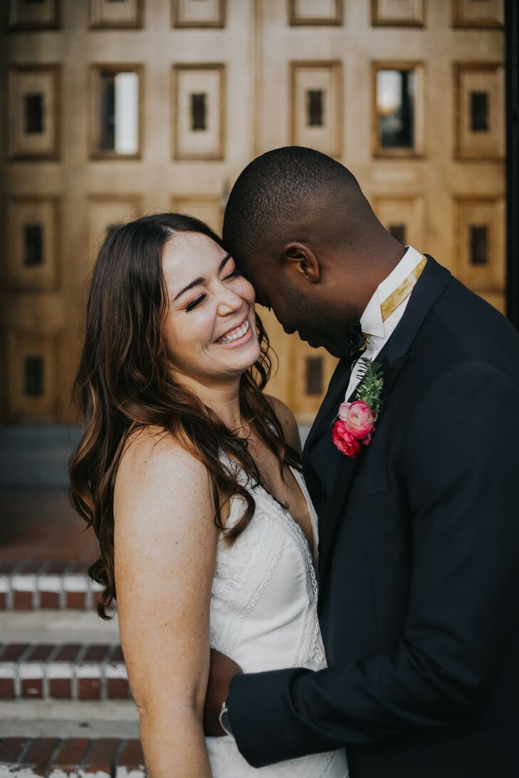 Couple Laughing During Wedding Portraits at Ebell Long Beach in California