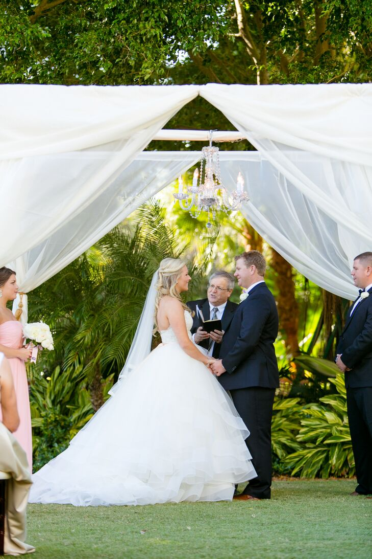 Once she decided on the dress, the pros at Bella Bianca Bridal Couture were ready to show her the matching veil. It was designed with white tulle and had the same bold, white trim as her skirt. The accent also fit perfectly into her down, curled hairstyle.
